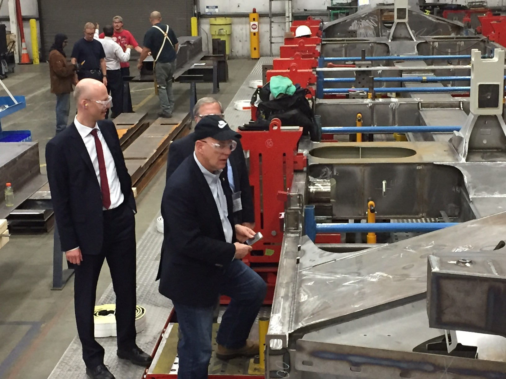 Jeff Knueppel, SEPTA General Manager inspects the first frame assembly for new SEPTA locomotive with representatives at Siemens Rail Manufacturing Plant in Sacramento, CA. (frame assembly in this image is upside down to facilitate this step of the fabrication).